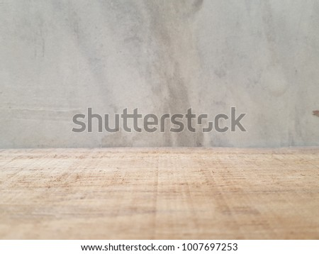 Empty wooden table and cement background  with space.Empty for product  display. Ready for product display montage. Fair in blurred and de-focus, Soft focus,Select focus #1007697253