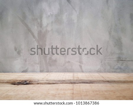 Empty wooden table and cement background  with space.Empty for product  display. Ready for product display montage. Fair in blurred and de-focus, Soft focus,Select focus #1013867386