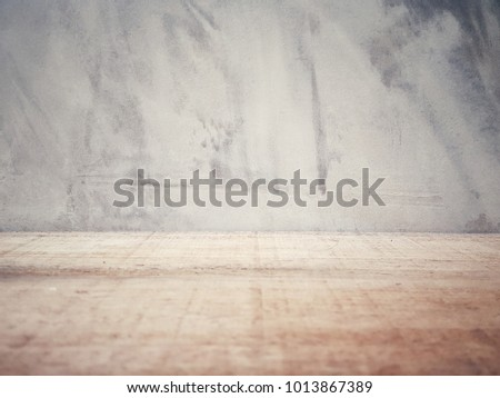 Empty wooden table and cement background  with space.Empty for product  display. Ready for product display montage. Fair in blurred and de-focus, Soft focus,Select focus #1013867389