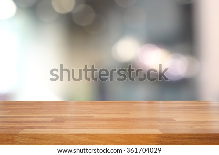 Empty wooden table and interior background, product display,blurred store with bokeh