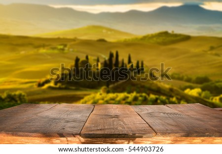 empty wooden  table and tuscan...