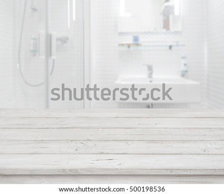 Empty wooden table for product display on blurred bathroom interior