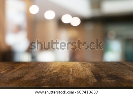 Empty wooden table in front of abstract blurred background of coffee shop . can be used for display or montage your products.Mock up for display of product #609410639
