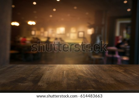 Empty wooden table in front of abstract blurred background of coffee shop . can be used for display or montage your products.Mock up for display of product #614483663