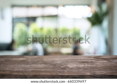Empty wooden table in front of abstract blurred background of coffee shop . can be used for display or montage your products.Mock up for display of product #660339697