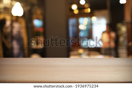 Empty wooden table in front of abstract blurred background of coffee shop . wood table in front can be used for display or montage your products.Mock up for display of product Foto stock ©