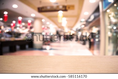 Empty wooden table  in front of abstract blurred background of shopping mall and people . can be used for display or montage your products.Mock up for display of product #585116170
