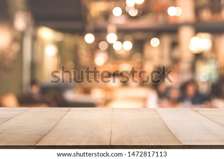 Empty wooden table in front of Blur background of coffee shop or restaurant interior abstract. Using for Mock up template for display of your design or montage  products. #1472817113
