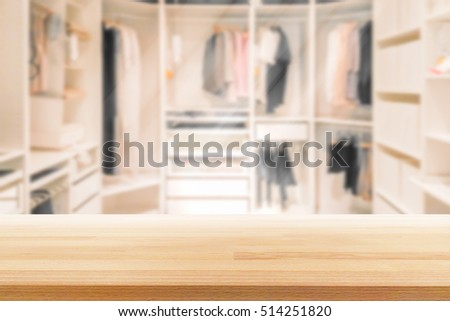 Empty wooden table on a background blur closet in the room  for display or montage your products #514251820