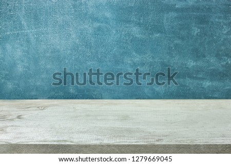 Empty wooden table on grunge background for product and food display montage #1279669045
