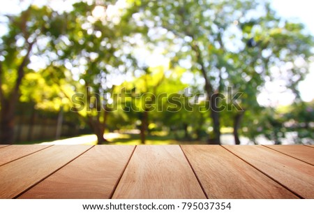 Empty wooden table on nature background #795037354