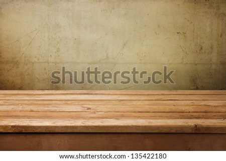 empty wooden table over grunge...