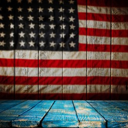 Empty wooden table over vintage USA flag background. Ready for montage. USA national holidays concept.