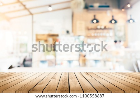 Empty wooden table space platform and blurred resturant or coffee shop background for product display montage #1100558687