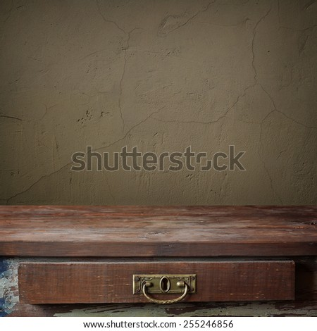 empty wooden table with a box against a wall. template.