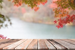 Empty wooden table with autumn background for product display montage