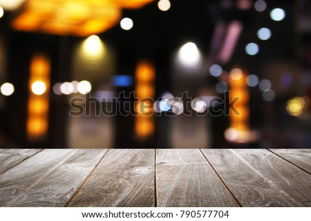 Empty wooden table with Blur Background, for your photo montage or product display, Space for placing items on the table, Mock up for display of product. #790577704