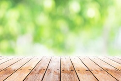 Empty wooden table with blurred city park on background. concept party, products, spring.