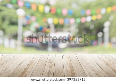 Empty wooden table with blurred party on background,  fun / spring concept #397353712