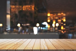 Empty wooden table with blurred restaurant kitchen background. Wood table top with background.