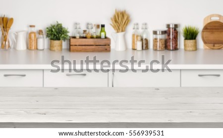 Shutterstock Empty wooden table with bokeh image of kitchen bench interior