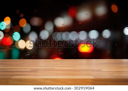 Empty wooden table with colorful  night light bokeh circle shape background. product montage display