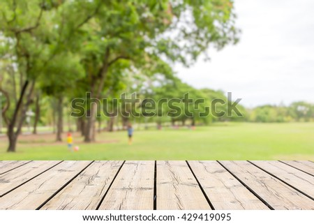 Empty wooden table with garden bokeh for a catering or food background with a country outdoor theme,Template mock up for display of product #429419095