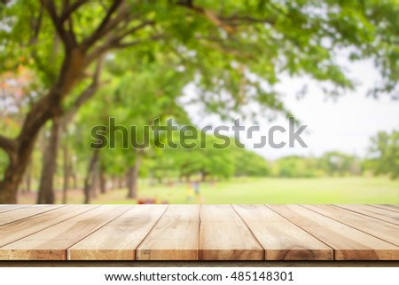 Empty wooden table with garden bokeh for a catering or food background with a country outdoor theme,Template mock up for display of product #485148301