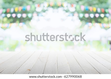 empty wooden table with party...