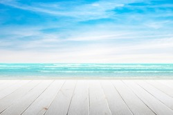 Empty wooden table with party on beach background blurred. Concept Summer, Beach, Sea, Relax, Party.
