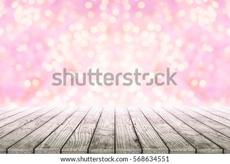 Empty wooden table with pink bokeh background blurred. Concept celebration, happy, romantic, art, valentines, love, wedding #568634551