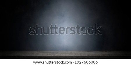 Empty wooden table with smoke float up on dark background for showing or design backdrop. ストックフォト ©