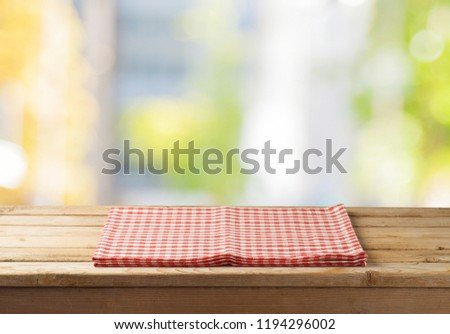 Empty wooden table with tablecloth over abstract bokeh background. Mock up for display or montage product #1194296002