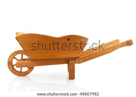 Empty wooden wheelbarrow for the garden isolated over white