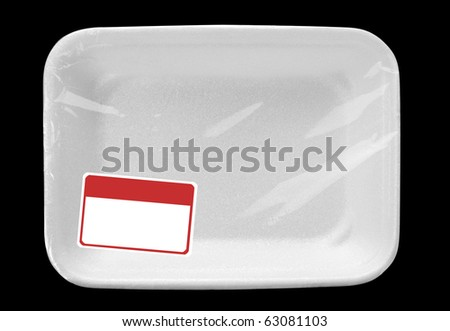 Empty wrapped white food tray with blank label. Isolated on black