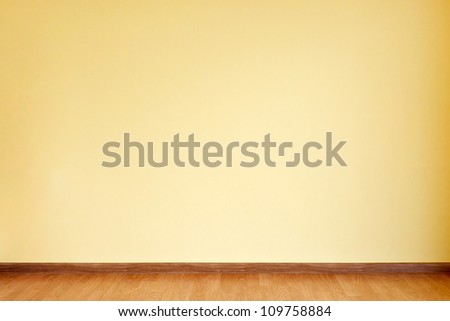 Empty yellow wall and wooden floor room