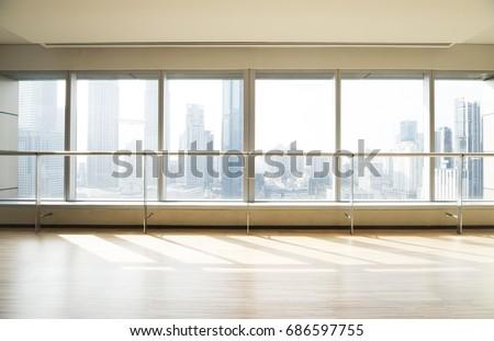 Empty yoga studio and cityscape