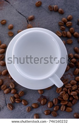 Empy cup and coffee bean. Top view with space for text