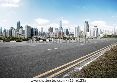 emtpy asphalt road and cityscape of shanghai in blue cloud sky