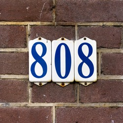 Enameled house number eight hundred and eight, on three separate plates.