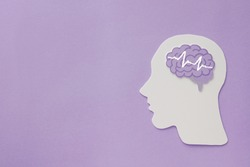 encephalography brain paper cutout on purple background,autism, Epilepsy and alzheimer awareness, seizure disorder, world mental health day concept