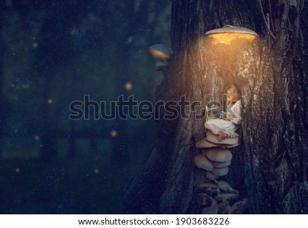 Enchanted forest - little girl sitting under the glowing mushroom, reading her book; Fantasy,  nature, fairy tale;