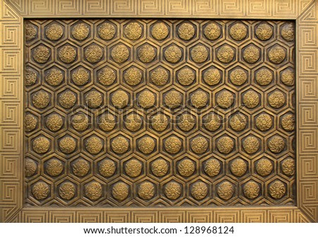 enchased in metal decorative pattern on the stone wall #128968124