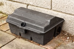 Enclosed Rat trap for laying poison to kill small mammals without the risk of harming larger animals used by pest control services