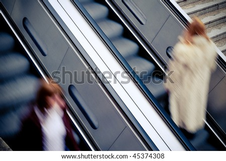 Encounter of two red-haired women on an escalator