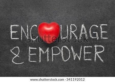 encourage and empower words handwritten on blackboard with heart symbol instead O