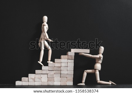 Encouragement and support. Career growth and coaching. Conceptual articulated mannequin composition. Copy space. #1358538374