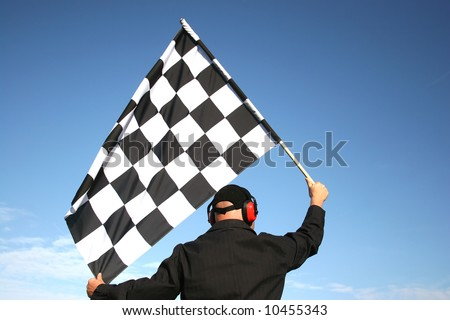 end of a race, man with finishied flag