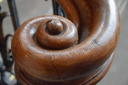 End of an antique staircase handrail in spiral form