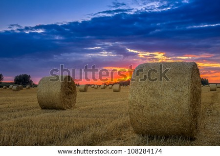 End of day over field with hay bale in Hungary- this photo made by HDR technic